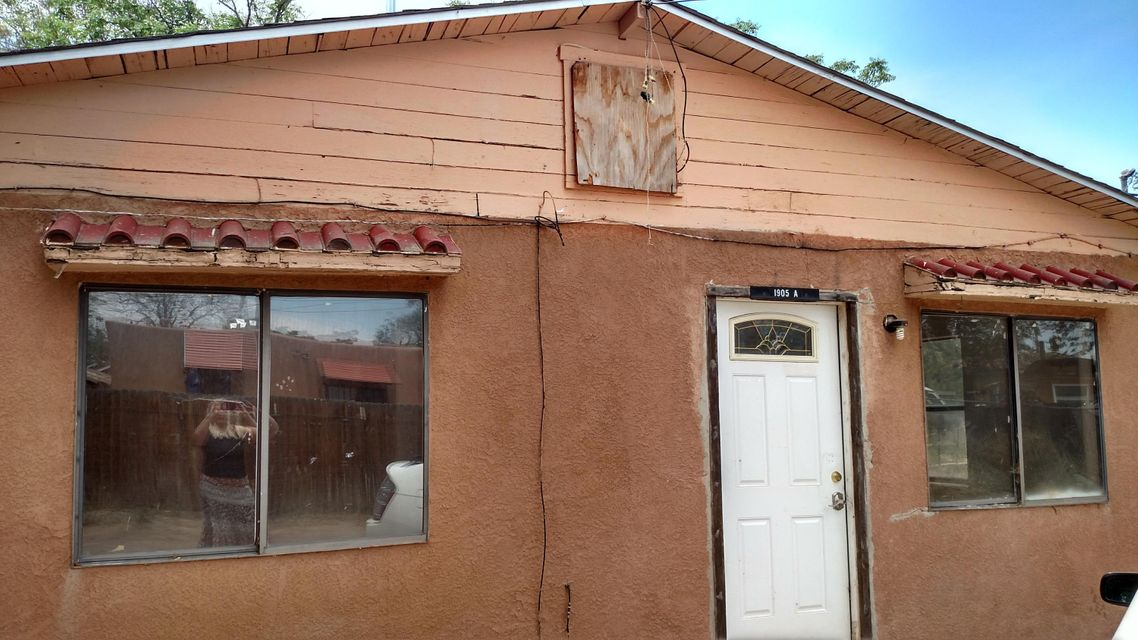 This cute little home tucked away is the perfect starter home.  Recently painted with all new flooring, it is now ready for a new owner.  Owner financing at $69,900 available with at least 10% and no call on 20-year note at 7.5%.  Don't miss the opportunity to make this one your own. Closing at American Escrow.