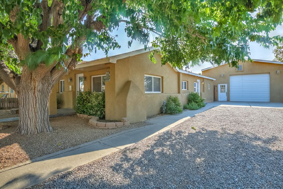 Must see this darling and updated 2 bed 2 bath home in the heart of Old Town. Boasting large rooms, new paint and carpet (June 2017), granite counter tops, stainless steel appliances, hardwood floor, jetted tubs, travertine tile, and a huge 26'x38' garage/studio/workshop, this home has it all.  Perfectly located with easy freeway access, close to shopping, restaurants, parks, bike trails, museums, live entertainment, and galleries.  This home has been extremely well maintained exuding ''Pride of Ownership'' Don't miss this opportunity!