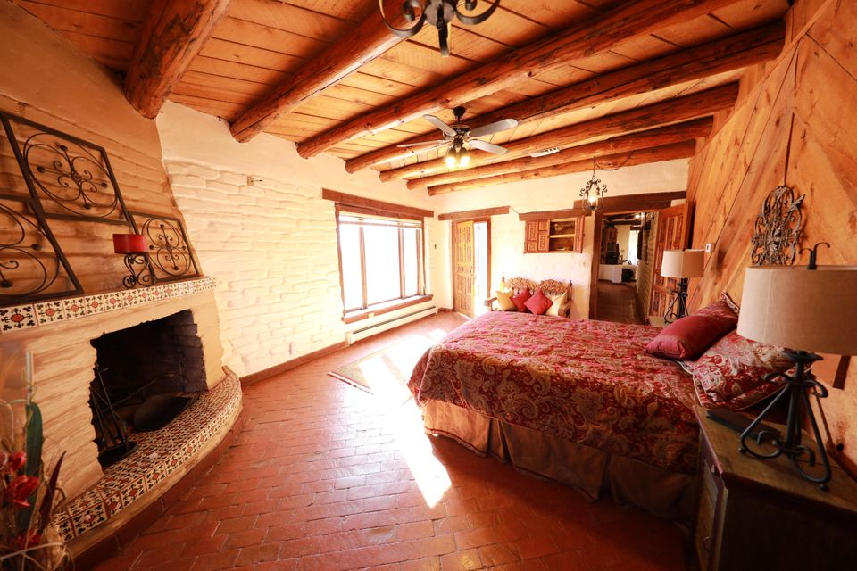 New Listing! Welcome to a unique opportunity in Placitas NM! The exquisite home is a tasteful hand built adobe build on over 7 acres of land! The home is Move in ready and Brand new stucco to be applied by seller. Color to be chosen by the buyer!