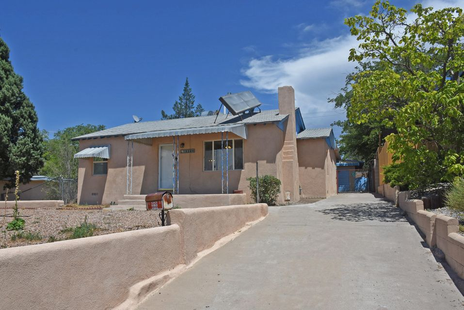 Desirable UNM/KAFB area! Pueblo Del Sol Golf Course nearby! Lots of updates in this terrific casita! New roof coming August 2017. Gleaming refinished hardwood floors in L/R, Hallway, 2 B/Rs. Fresh paint, new stucco, refrigerator and stove in 2017. All appliances convey. Recent D/W, W/D, Furnace & Hot Water Heater, Windows. Large Bonus Room (17'8 X 16'4)w/skylight and 2 ceiling fans,could be 3rd B/R, hobby/den/study. Over sized 1 car garage w/workshop/studio. Living Room with cozy fireplace and ceiling fan. Superior Home Inspection (free re-inspection) done and repairs completed.