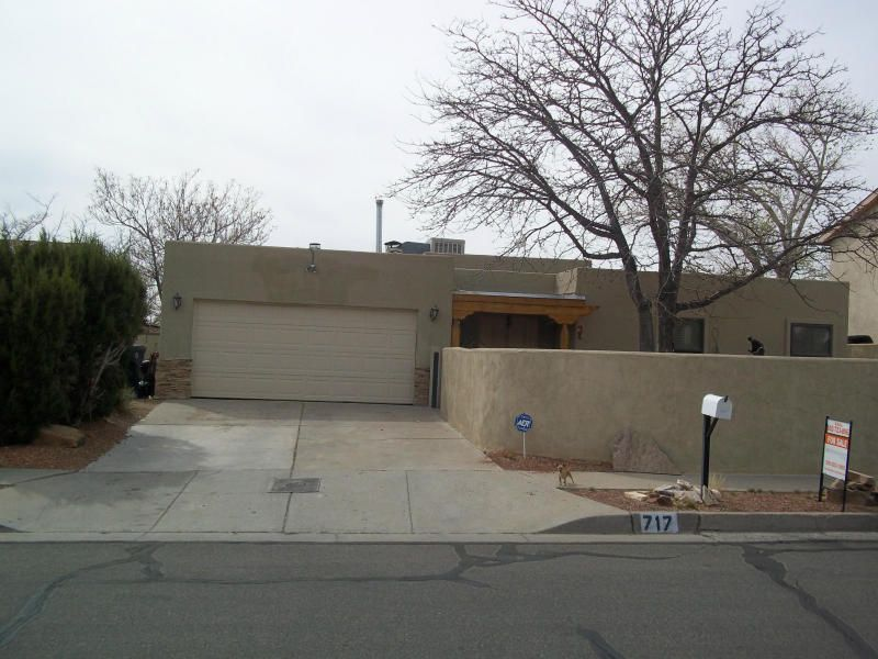 East of Tramway with views for under $280K! High Desert Style Home with open layout & high ceilings. 4 Brs, 3 baths with 2 master suites and huge living areas.  High End Kitchen with GE stainless Steel appliances. Huge Covered deck for outdoor entertaining & those gorgeous New Mexico sunsets! Large private landscaped backyard. Walk to Copper Trail head in the Sandias, walking & bike paths. Short drive to Four Hills Shopping Center & I-40.