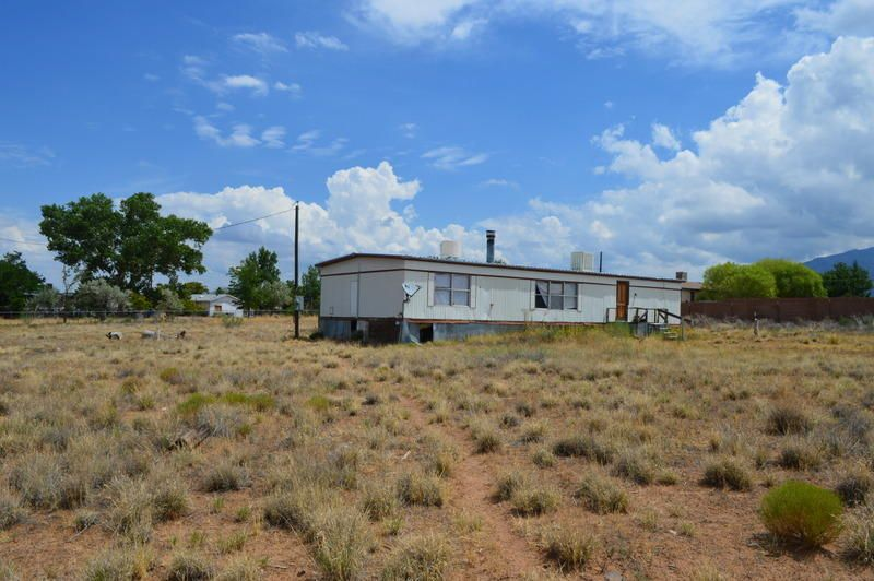 Perfect property for the handyman! 3 bedroom, 2 bath manufactured home in need of TLC. Home sits on almost an acre with great views!