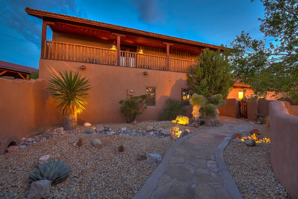 Stunning adobe and log style home located on 1 acre in the tranquil setting of Placitas. Home features 2,562 sf with 3 bedrooms, 2.5 baths, an office, 2 living areas, a sun room, workshop & large RV carport! Amazing wood beamed ceiling throughout. Living room w/ gorgeous 16ft adobe fireplace. Kitchen hosts upgraded cabinetry, granite countertops, built-in oven/microwave, cooktop, brick flooring, skylight and a breakfast nook. Enjoy the completely private master retreat with adobe accent wall, fireplace & private balcony with amazing views of the mountains! Bath hosts a deep garden tub, custom walk-in shower, dual sinks & walk-in closet. Resort like backyard w/ stone pool deck, salt water pool, hot tub w/ waterfall and unobstructed views! RV carport capable of storing tallest of 5th wheels!