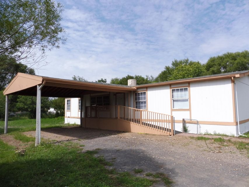Beautiful Titan Manufactured Home, in the Beautiful Town of Peralta, NM. This home is very spacious with 3 Bdrm., 2 full bath, and a huge addition den or family rm. with office or could be a fourth Bdrm. Nice spacious kitchen with lots of cabinet space. Cozy sitting area with fireplace, formal dining rm., large living rm. Fresh paint and carpet throughout. Step outside to a Nice open patio porch out back, 42x12 storage shed, mature fruit trees, lots of room for some farm animals. Pipe fencing all around. All situated on .81 Ac. lot.