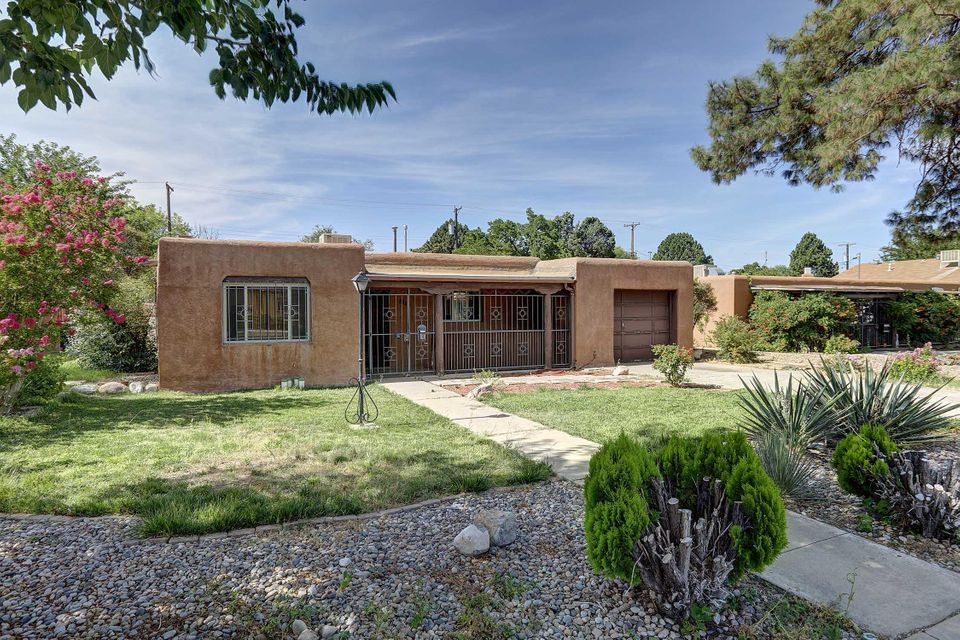 This Adobe Gem in NE Albuquerque is really something else! The location is amazing with quick access to the freeways, Shopping, UNM, Kirtland Air Force Base, as well as Nob Hill. The backyard is huge and has endless possibilities. The Front Porch is enclosed and built for comfort. The home will not to last long. Seller is willing to work with buyers on Carpet In Bedrooms.