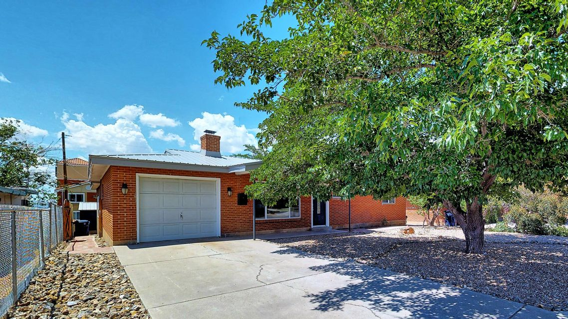 Welcome home to this fantastic UNM remodel. 3 bedroom 2 bath 1 car garage home blends classic and modern. Re-imagined in 2017 with all the upgrades. The original living area and bedrooms have refurbished original wood floors and a fireplace. Massive family room with centerpiece gourmet kitchen; new granite, new appliances, soft close cabinets and more! Master bedroom has en-suite bath; new updated bathrooms too! The other two bedrooms are light and airy with lots of closet space. Outside is perfect for entertaining with a spacious covered patio and large Xeriscape yard with mature fruit trees. Inspections and repairs are already done - this one is ready to go!