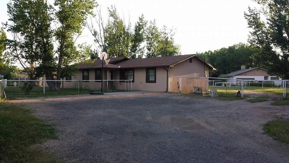 Conveniently located next to shopping, restaurants & all Situated on 3/4 acre, all piped fenced and yes bring your horses or animals! Must mention 4 BEDROOMS & 2 baths, Beautiful Tile, nice & cozy feeling and ready for immediate move in! Rose bushes, 12 x 12 storage shed and also an added storage / Garage unit. This is a must see!