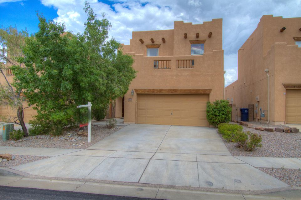 Beautiful SE Heights home in desirable gated community. Enjoy this 3 bedroom 2.5 bath home. Master suite is downstairs. Large great room with cozy Kiva fireplace.Large open kitchen with dining room. Seller is motivated make offer today.