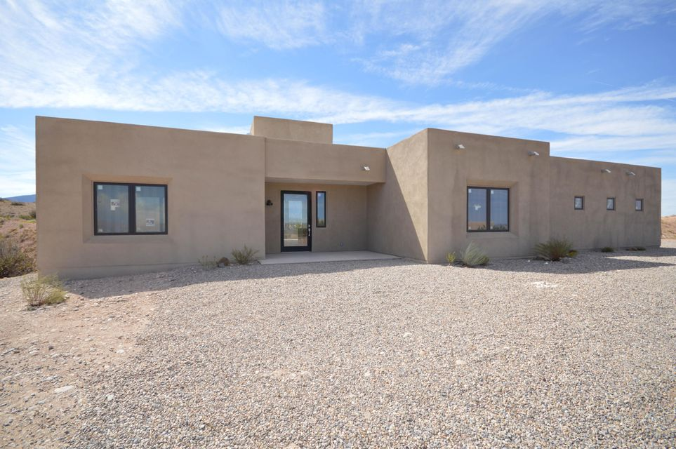 This new contemporary southwestern home has a bright open floor plan with a large greatroom with high ceiling and gaslog fireplace. Kitchen has custom alder cabinets, stainless appliances and marble countertops. Hugh master suite has sitting area with fireplace, large walkin closet and bath with dual sink vanity jetted tub and separate shower. Home has unobstructed views from greatroom, master bedroom and patio.