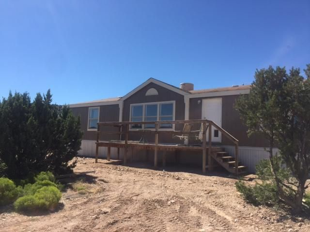 Great opportunity to own a home in Placitas! New Roof,2x6 construction, tape and textured walls, new carpet and tile throughout. Kitchen has new cabinets and counters, and floors. New paint exterior and interior throughout. Private well, and water softener. Great location great views. Priced to sell, owner financing available.