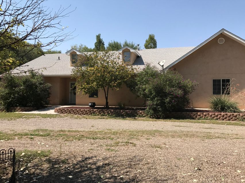This secluded home in a pastoral setting has it all. From the beautiful in-law quarters to the oversized 3 car garage, this home was custom built and shows smart planning with plenty of upgrades. Main  house has 1706 sf and the in-law quarters has 840 sf with large kitchens in both.  Did I mention Refrigerated Air and a pellet stove that keeps everyone comfortable no matter what the weather. Perfect for the extended family. Lovely private areas as well as plenty of roses and fruit trees.
