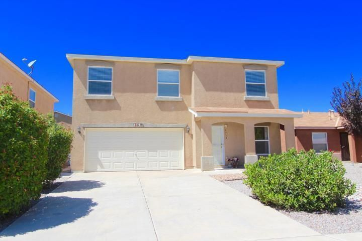 Spacious northern Rio Rancho Home. Two large living areas downstairs and a big open kitchen perfect for preparing family dinners.  Upstairs are 3 large bedrooms and one more living space.  Home is convenient to I25, Santa Fe and booming Enchanted Hills market center.