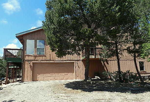 Spacious East Mountain property located on 2 wooded acres. Nice floor plan with a large deck to enjoy the serene mountain setting. Lots of windows and skylights means plenty of natural light. Fireplace insert is ready for you to install a cozy new fireplace. HUGE over-sized garage can definitely fit more than 2 cars! Awesome location yet not far from ABQ and just a few minutes from I-40 access. Peaceful mountain living awaits you!