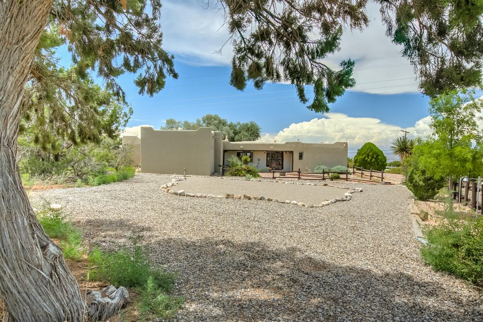 Impressive adobe home with guest house, workshop and barn. 3.25 acre flat, usable lot offers privacy and seclusion. Horse owners will love riding into the trails from the barn.  Commuters will find it easy with a location half-way between ABQ and Santa Fe, near the Rail runner station and only 5 miles from I-25.  The adobe home updates include the kitchen, master bath, additional bath, refrigerated air and a newer membrane roof. The fireplaces and sun room are sure to be enjoyed. The private guest house offers a kitchen, living area and bedroom. The compound includes a 4 stall barn with 2 paddocks and plenty of room and trails for riding. The 29 X 30 workshop will be a favorite for woodworkers and hobbyist.