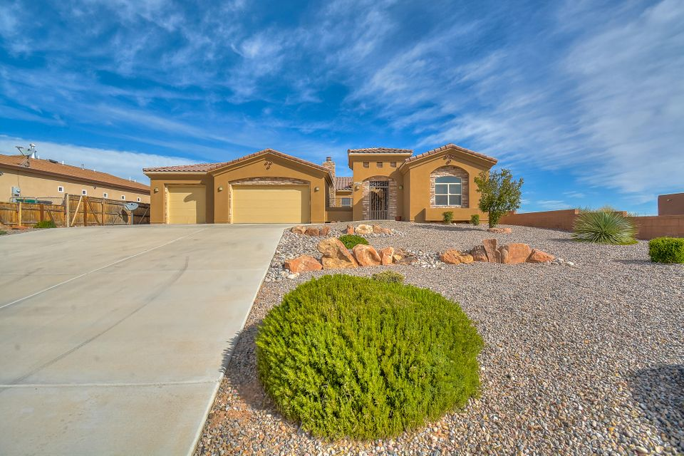 Stunning custom built beauty with casita located on a large half acre lot in the heart of Rio Rancho! Home features 3,061 sf with 4 bedrooms, 4 full bathrooms, 2 living areas and a 3-car garage w/ backyard access! Private gated courtyard w/ custom wood burning fireplace. Main living area with built-in media center, wet bar & custom fireplace w/ stone accents. Gourmet kitchen with upgraded cabinetry, granite countertops, built-in oven/microwave, gas cooktop,huge island with seating area, pantry and skylight. Master suite with a wall of windows and custom ceiling. Spa-like bath with his/her sinks w/ custom vanities and backsplash, walk-in shower with custom surround, huge jetted tub and massive walk-in closet.    Large backyard with covered patio, storage building and beautiful views!