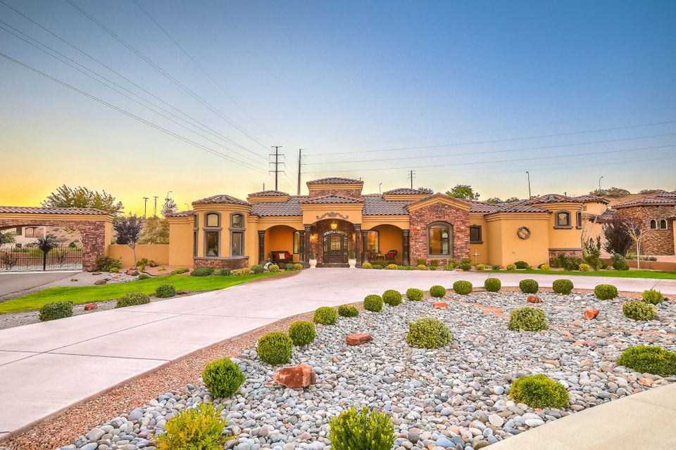 This Exceptional Tuscan single story Green Built Estate is situated on a 1.28 acre corner lot in the upscale Black Farm Estates. Lovely visual details greet you when you arrive at your new home. The Stone Entry boasts graceful Arches, Cantera Stone Columns and the Custom Metal Entry Door welcomes natural light to fill the foyer. The Grand Open Living Space offers the spirit of Tuscany with elegant drapery, Chandeliers, brilliant Custom Textured walls and Suede Paint throughout. This beauty has 4 bedrooms that are all En-Suites and gracious in size.  The luxurious over sized master suite offers a private retreat tucked away in its own separate wing. It includes a sitting room, a spa like bathroom and massive closet space. The master retreat bathroom has an oversized spa tub, his & her
