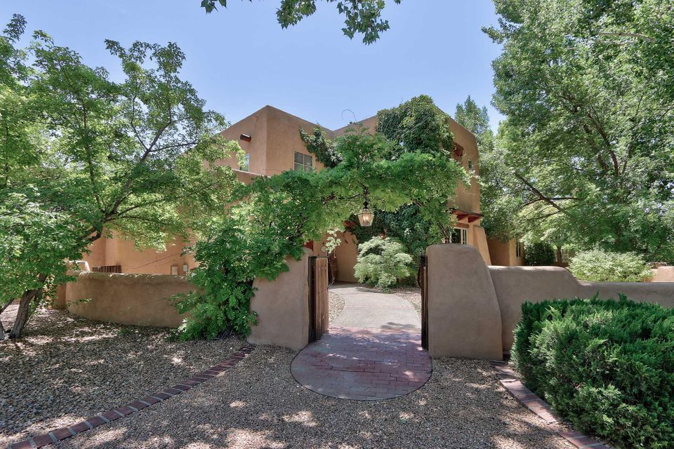 Rare resort living under magnificent cottonwoods down a private lane off Rio Grande. Private gated acreage backs to the acequia. Incredible salt water pool with ''beaches'', perfect for large-scale entertaining, includes spa and gazebo like outdoor kitchen,outdoor patios and water features. Major renovation in 2014 converted coolers to refrigeration and heating units,renovated gourmet kitchen w/ new appliances,lovely tile in bedrooms, kitchen area and guest space. Outdoor ''barn'' converted to spacious exercise space that is heated/cooled. Newer paint and stucco, wood refinishing as required. Cozy fireplaces and beautiful grounds create the ambiance for true luxury living. You must see this property to appreciate the renovation which made necessary updates while maintaining all the charm