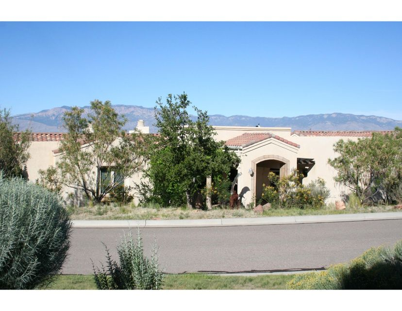 Brokers please do not call client per client's request. Beautiful John Lowe custom-built home located on a fabulous view lot in gated Oxbow Bluff. The home is designed to showcase the expansive views of the Sandia mountains, Rio Grande river, bosque & city lights. Quality features throughout including arched doorways, crown moulding, hardwood floors & travertine tile. The living room frames the beautiful views and features a stone fireplace and beamed ceiling. The impressive dining room has views and a barrel ceiling. The gourmet kitchen has custom cherry cabinetry, granite counters, large center island & top of the line appliances including Viking & SubZero. Spacious Master bedroom with an incredible en-suite bath with double sinks, soaking tub and separate shower.