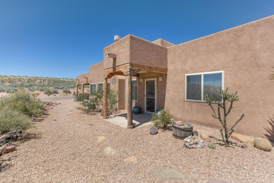 Two Bits Ranch is the best kept secret in Rio Rancho city limits; 360 views & fenced 5.18 ac Horse Property; Barn, tackroom, stalls & pipe fenced corral; Pueblo, 2 Bd, 2 Ba, Utility Rm (10 x 9.6) - can also be an Office, 2 Car Garage; W/in 1.5 miles of district schools, Minutes to hosp/shops/restaurants/entrtnmt; Own utilities: Electric (new Solar), Water, Septic, Propane; Home security; Home Warranty; Rubber Membrane Roof w/ warranty to 2029, Terminex warranty to 2024, New furnace & refrigerated AC w/ 10 yr parts & 1 yr labor warranties; RV Hook up; Inspections completed: Well, Septic, Home (Structural & Mechanical), Propane, Fireplace, Termite/Wood, Survey, Solar; Construction of 1 Bd Casita allowed for possible 3rd bd; Recent appraisal of $315k.