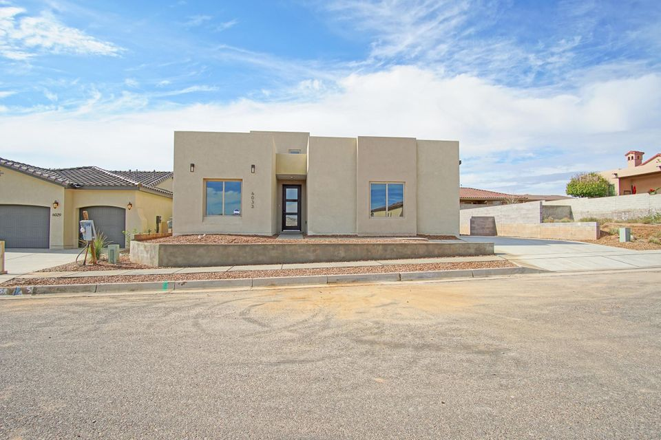 This beautiful custom built home in Mariposa by Fellowship Homes. The Arcadia Model is a desert contemporary home that fits perfectly into the New Mexico desert scape. This home has a great open floor plan with granite countertops in the kitchen and bathrooms, venetian plaster fireplace, Roof combo HVAC system, Low E Windows, large jetted soaker tub, Stainless steel appliances, Certified Termite treatment, 50 gallon water heater, and unbelievable 8'X 9' glass pocket doors opening to the patio making the home feel open to the outside patio. With an optional balcony you can find yourself walking up to the open balcony you will be filled with anticipation to see NM's wonderful sunsets against the Sandia Mountains.