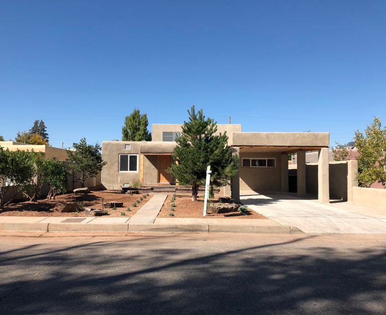 TOTALLY REMODELED HOME in the UNM Area! Just blocks away from NOB HILL. This is a Smart Home where you can control the Locks and Lights with your phone. Flooring is Water Resistant Wooden Laminate and Lights are remote controlled. All New Plumbing Throughout the House. Led Lighting throughout the house. New Refrigerated A/C and Furnace. Beautifully landscaped and a Patio that makes you want to just sit and hang out in. Gorgeous Open Floor plan that leads your eyes to this Stunning Kitchen. 3 Bathrooms that are Elegant. Can be a 5 bedroom 3 bath house or Two Houses in One. 3 beds 2 baths downstairs and a 2 bedroom 1 bath and Full Kitchen Upstairs or In Law quarters. This is like buying a Newly Built home!
