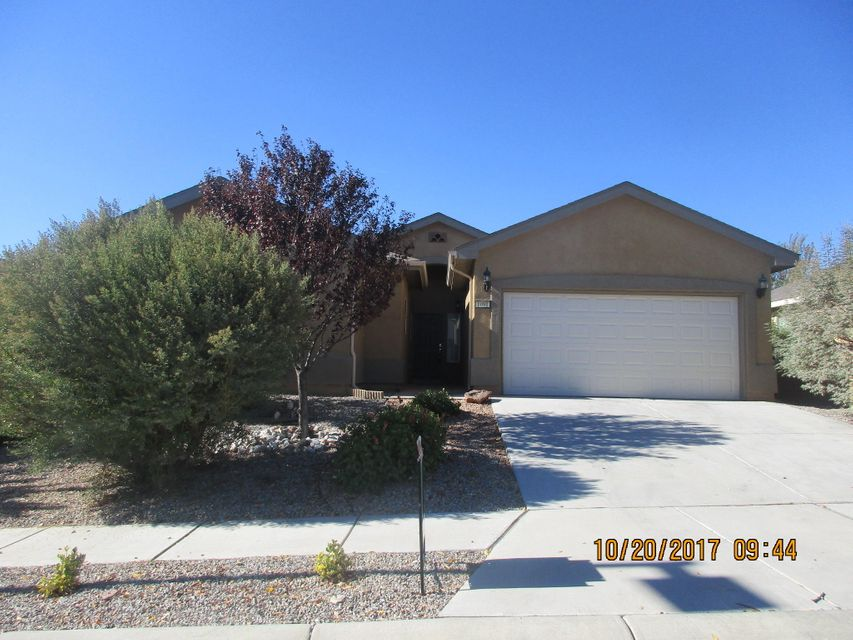 4 bedroom home in Los Lunas!!! This home features an open living and kitchen area with built in entertainment center, formal dining room, 4 nicely sized bedrooms, master suite has large master bath with his and her sinks, nice garden tub and separate shower, walk in closets, large yard, xeroscaped front and back yards for easy maintenance, close to free way access.