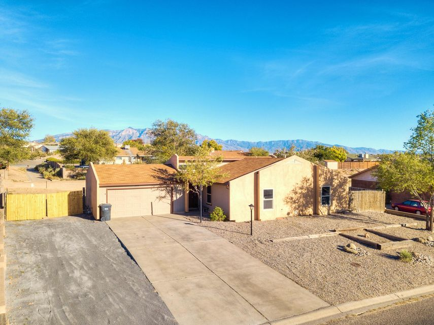 Great opportunity to own a home in the heart of Rio Rancho!  Featuring several updates roof(2015), furnace and refrigerated air(2016), newer windows, and side yard fence and front landscaping.  This home has fresh interior paint and new carpet!  Outside you will find a great covered patio and large lot that features backyard access for all of your toys.  There is no HOA and home was replumbed in 2009!  Schedule your private showing appointment today!