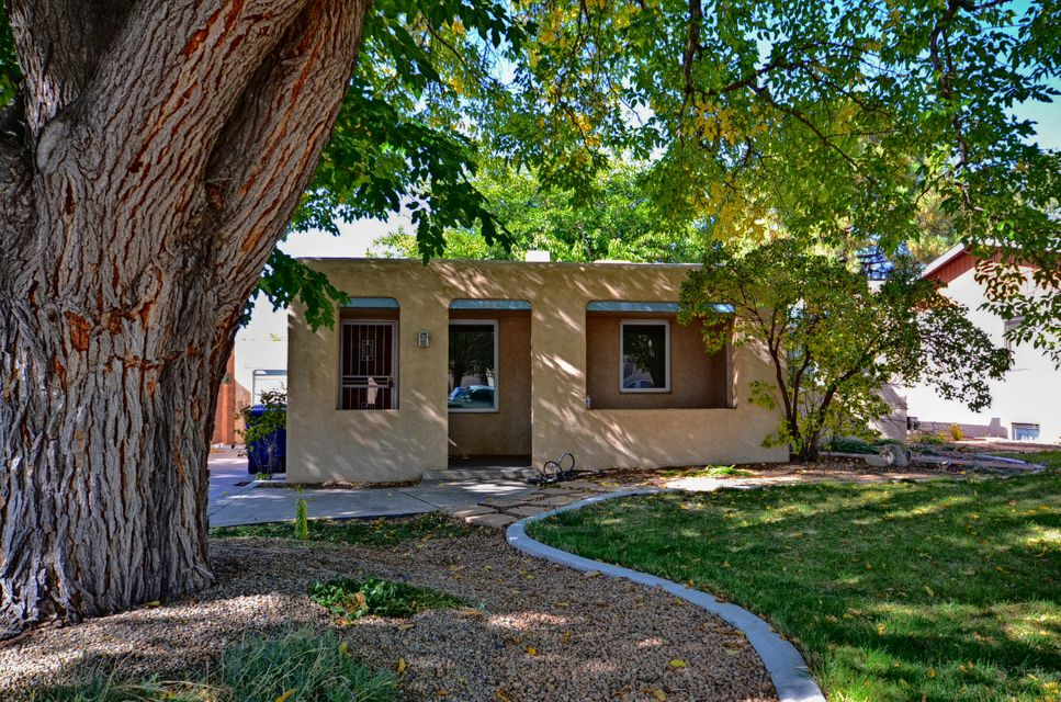 This is a UNM classic! No one added any weird rooms and it still has a garage! What a gem. Beautifully situated in a special pocket between Campus & Lomas in walking distance of UNM.Updated kitchen w/granite counter, new cabinets, dishwasher, but keeping in character with the home, the original Frigidaire stove with a deep well! WOW Updated bathroom w/Corian counter and ceramic tile floor.Living Room and Dining Room w/hardwood floors.  Fireplace in Living Room.  Updated electrical. TPO Roof. Thermal windows. Appliances stay! Garage is a hobbyist's dream with many electric outlets and hard piping for an air compressor.  Alley access in the rear with secure gate for additional parking.Walking distance to UNM Hospital,UNM,Nob Hill, Jefferson Middle School, Monte Vista Elementary & churche