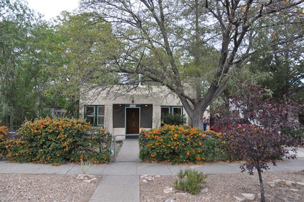 Pueblo Style Awesome located University Home! UNM just blocks away! CNM & Sports Arenas around the corner! Screened in porch, off street parking, Living room w/fireplace, hardwood floors thru-out except for the Saltillo tile floors in the updated kitchen with long breakfast bar, awesome gas stove, French door stainless refrigerator, huge rear dining area, access to backyard & covered patio, three bedrooms & three bathrooms! Separate Access from the Patio both Master bedrooms, south has glass block shower and French doors to back patio! Lots of updates! This one has a little of everything! Alley access! Sprinklers, Refrigerated AC, Updated windows & More! All this and no need to pay for parking at UNM or CNM! A skip & jump to eateries, Nob Hill, bus lines, shopping! Potential Investment too