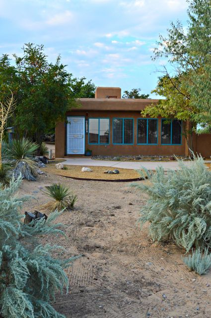 Open House Sat Nov 5th 1-3pm. Charming Casita on a 1/2 acre lot in a sought after Rio Rancho neighborhood. This beautiful Pueblo Style home is modern and sleek, with an open floor concept and over 38K in new renovations. Home features 2 living rooms, 3 bedrooms, garage is perfect for a studio space, a workshop, or a sunroom, a back porch patio for BBQ and entertaining, a fenced in courtyard, and roof top access to the most breathtaking, panoramic views of the Sandias, Manzanos, and the lights of downtown ABQ. Enjoy the ease of cleaning and maintaining a smaller home, or expand into the back 1/4 acre lot with the stunning unobstructed views of the Sandia Mountain. Wouldn't you love the convenience of a COMPLETELY renovated, energy efficient ,move in ready casita?