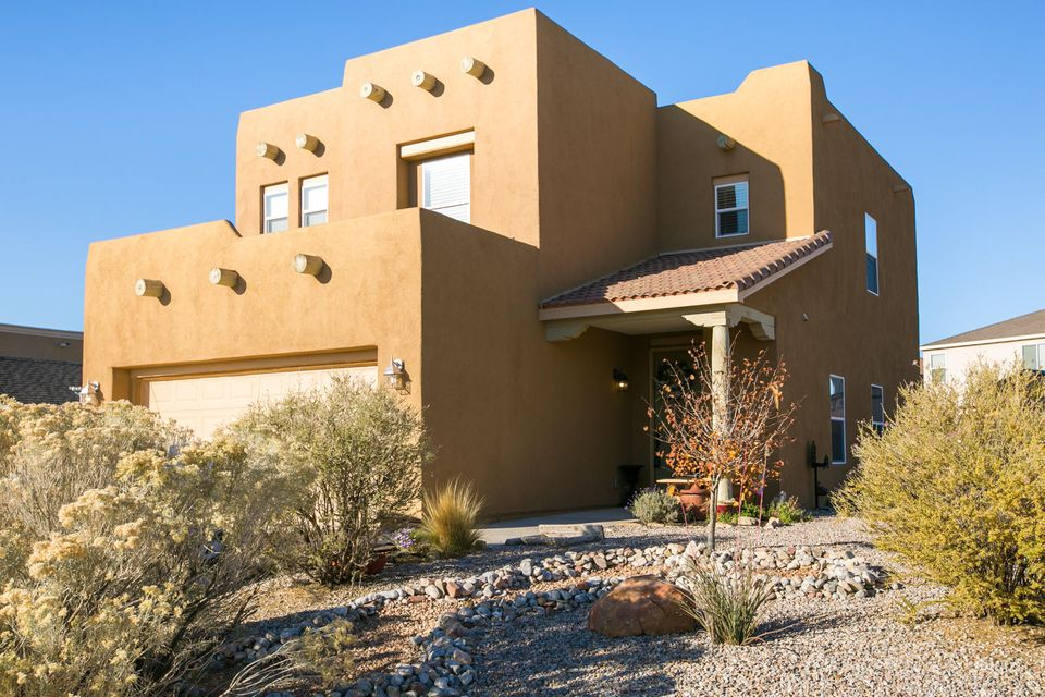 PRICE IMPROVEMENT on this fantastic home in Enchanted Hills. This pueblo style beauty sits on a generously-sized corner lot and offers 3-4 bedrooms, 2 full baths and a half guest bath. Large kitchen with an abundance of cabinets and counter top space, stainless steel appliances, recessed kitchen lighting and pantry. Bedrooms are located upstairs along with a loft that offers an additional living space. Easy care landscaping, 2 car garage, backyard access, extra storage provided by a tough shed that carries a 10 yr. transferrable warranty and space for RV parking. Provides an easy commute to UNM West, Cleveland High School and I25. The Seller is also offering  $2000 Buyer closing cost incentive with an acceptable offer and timely close.