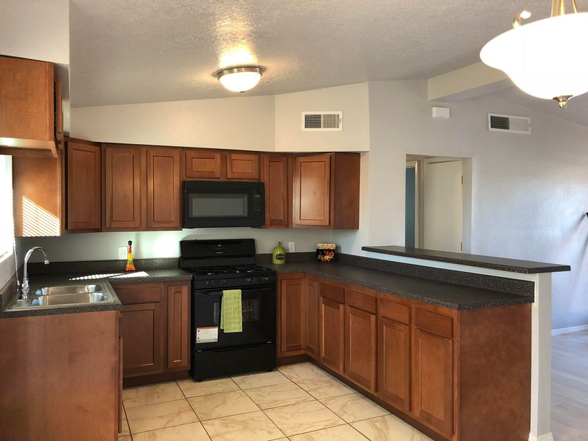 Beautiful remodeled home, new kitchen cabinets, flooring, vanities, paint, windows, stucco, landscape and much more.Do not miss this opportunity