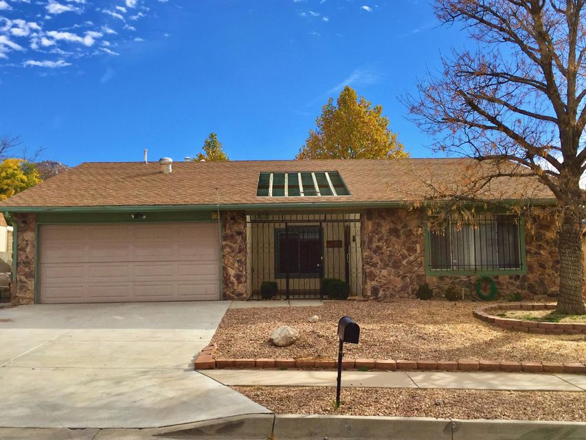 3 bedroom/2 bath home at the base of the foothills on the east side of Tramway. Walk just a few blocks to the trails. Stunning mountain view from backyard.Laminate flooring. 2 Car garage. Two living areas, dining room. Kitchen is open to great room.  Needs a little Tlc. (Paint and Carpet)