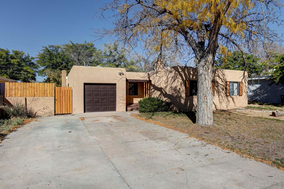 Wow! Location,location, location! Check out this wonderful home!  This rare gem features spacious bedrooms,beautiful flooring, and a spacious backyard. The design of this home features all the fixings for a traditional New Mexico style home!  This home will not be available for long, now is your chance to make it yours!