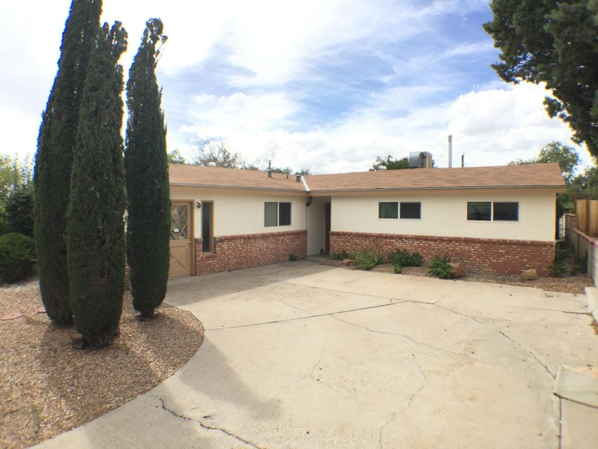 Recently Updated! Brick-Stucco and Pitched Roof, Flexible Floor Plan, Two Concept Spaces or a Fourth Bedroom. Fresh paint and carpet 2017. Private Master bedroom with Patio Atrium doors and Zoned Heat and Cool. Walled backyard for Privacy, with covered Patio and Storage Shed. Desirable UNM Loma Linda neighborhood! KAFB/VA & UNM Hospital, Downtown, Freeway access! e! All existing Appliances convey (Dishwasher 2017). Ceiling fans, built-in shelving, new sliding Doors and Front Windows 2017. Furnace 2014, 2 Evaporative coolers 2016, Water Heater. 2014, Water Softener 2014. Updated Electrical service. Move in Ready! Your neighbor is Pueblo Del Sol Golf Course.