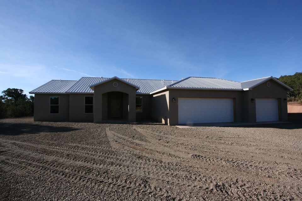 NEW APPRAISAL $393,000 WHICH IS $8,000 HIGHER THAN LIST PRICE.. Beautiful home in the east mountains secluded behind the trees with custom cabinets granite tops in kitchen, utility and master bath with travertine top in hall bath.Refrigerated air, oversized 3 car garageon a 2 acre treed lot.