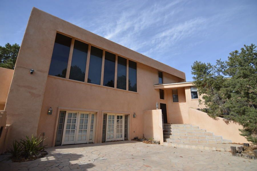 Check out this large home on a quiet cul de sac in Sandia Heights. This home features 3 bedrooms, a huge living area, large faimily/game room.  Lots of large pine trees surround this home on a large lot. This is a great location, with great views, check it out.  The home does need a lot of updating.This home is sold as is.Buyer to pay for all inspections.