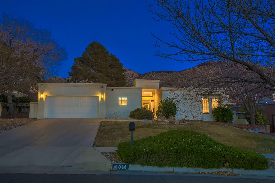 You are going to LOVE this home! (Please check out the 3-D Walk-Through Video under the photo section) Located on a cul de sac in the beautiful Glenwood Square subdivision near the base of the majestic Sandia Mountains, it is near to hiking trails, shopping and quick freeway access! This house is set up beautifully for entertaining with two large living areas and both formal and informal dining rooms. The home beams with natural light with near floor to ceiling windows. The home was  recently updated with new appliances and rich quartz matching counters in the kitchen and all baths, sparkling fixtures plus gorgeous new tile and carpet. There is REFRIGERATED air and two   (Please see MORE...)