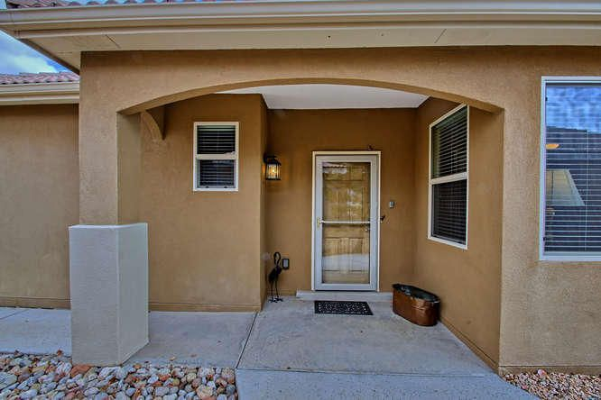 """You don't want to miss this home located in Del Webb Alegria - a Gated Community in Bernalillo.  Many upgrades have been added to make this ''Carlsbad'' floor plan home warm & inviting.  2 bedrooms, 1.75 baths, 2 car garage plus a FLEX room. refrigerated air, skylights,  fireplace enhanced with mantel, tile flooring throughout, Kitchen features 42"""" cabinets with crown molding, granite counter-tops. spacious pantry. Many NEW light fixtures have been added. The covered patio has pull down awnings for maximum privacy.  Outside grill is included.  Back yard is exquisitely landscaped with beautiful flowering shrubs. Double sinks in master bath. Hollywood designed closets designed for maximum storage. Close to shopping & the Rail Runner."""