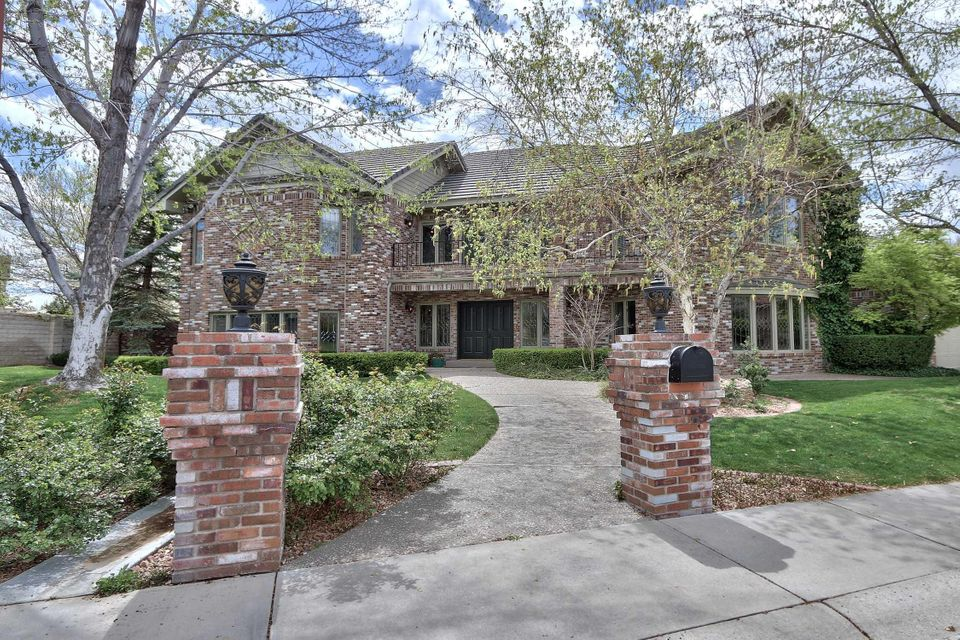 Prestigious Home on Zia 8 of Tanoan Golf Course/Refrigerated AC. Open the front doors to an elegant foyer with marble floors and a sweeping spiral staircase with balcony overlook. Entertainers Kitchen with gas stove top, double ovens,sub zero, wine refrigerator, granite island. Master suite with Fireplace pellet stove, balcony, sauna, steam shower, jetted tub and more. Family Room with built in cases, wood floors,Formal Dining with Beveled glass entry doors, Library with private patio and gas log FP, Bookcases, wood floors,Backyard with pool, fire pit, water falls, hot tub with water features, warp around covered patio of entertaining. 3 additional bedrooms/one down.Impressive Wine Cellar with brick floors, Vintage charm with wine bottle storage. A grand home any family to enjoy.