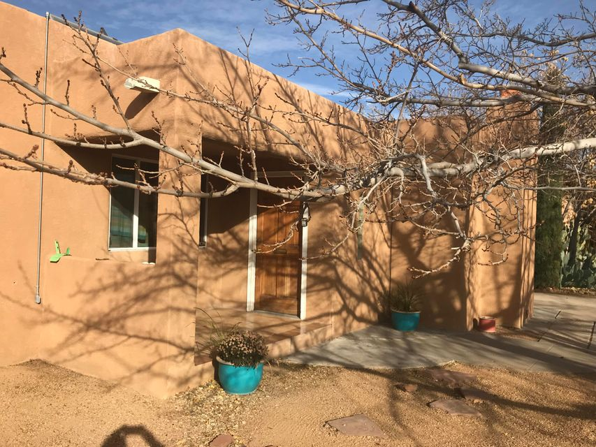Welcome the opportunity to live in Parkland Hills in this 2-3 bedroom home complete with a lap pool! Two separated living spaces--one with carpet other with hardwood floors; dining area off kitchen. Choose to use the bedroom separate from the other two as either the master suite, complete with a full bath and walk-in closet, or maybe as an office/library space--has it's own entry.  The layout of the home flows very nicely, with skylights bringing in the natural light. Lap pool has a sweet pool house complete with a 3/4 bath! Outside back deck with covered patio.  Both refrigerated air and evaporative cooling! Solar hot-air collector (info attached). Complete with ample driveway and extra parking spaces.