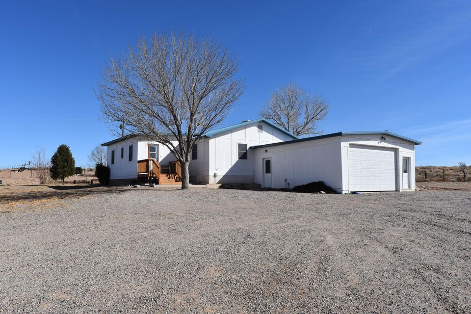 Beautiful Manufactured home with lots of upgrades. This 3 bedroom, 2.5 bath home on 1.25 acres also has a large build out on the front for an office or possible 4th bedroom, a build out off of the rear for the laundry room, storage and craft area.  Walking into the home you are greeted by a large pellet stove in the main living room and a family room. The Oversized Kitchen has tons of storage in the cabinets and large island that separates the kitchen from the dinning room. Large master bedroom has an oversized tub with shower and walk in closet. Bedrooms 2 and 3 are at the opposite end of the home from master and are great sized for a large family.Home has several upgrades such as light tubes, ceiling fans, metal roofing, multiple evaporative coolers and a built on 2 car garage.
