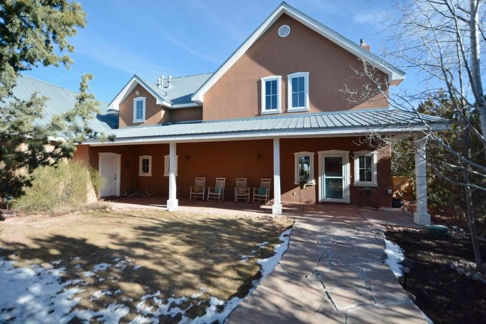 Elegance, style & warmth define this Northern NM home located in PAA-KO. Situated on 4 acres this property features: Chef's kitchen w/ nook, double ovens, 6 burner gas cooktop,concrete countertops,cherry cabinetry, stainless island. MBR on main w/ walk in closet, large bathroom w/ double sinks & pellet stove. Beautiful living room w/ custom gas log insert wood stove, lots of windows & access to covered patios for indoor/outdoor living.Flex room on main is a perfect spot to work or play!Upper level boasts fantastic ceilings, stunning mountain/Santa Fe views in ALL 4 oversized rooms, 2 full bathrooms, laundry chute & walk in storage closet. Enormous 4 car garage w/ storage, workshop area & attic.Custom cherry wood & pigmented concrete flooring, architectural detail galore and tons more.