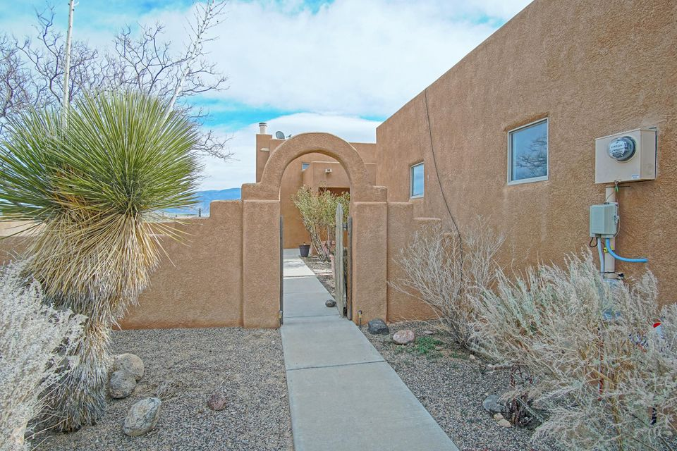 Open House Sunday 5/6 1-3 pm.Beautiful 5 bedroom custom home that sits on the top of a hill on one acre in Rio Rancho Estates.  Amazing Views!!!  Nice welcoming courtyard in front of the house & large fenced backyard with backyard access.  Private master bedroom upstairs with incredible view deck.  Three car garage, high ceiling in living room, gas fire place.  Possible owner financing!