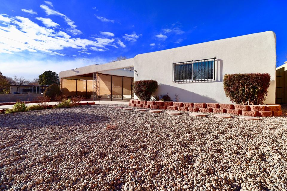Gorgeous NE Albuquerque home that has been remodeled and renovated and is ready for a new owner. New flooring throughout the home, custom paint, updated appliances and fixtures, this home is an absolute beauty!!! Come by take a look and put in an offer!!!