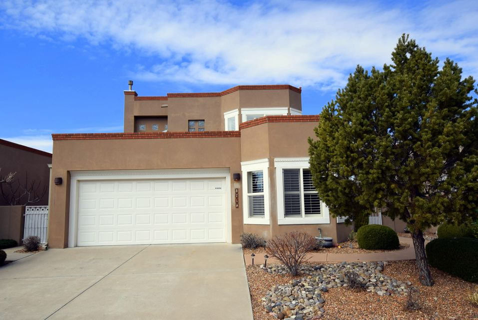 **BIG PRICE REDUCTION**  Model home built by Mechenbier.  This multi-generational home has a courtyard entry, a custom chefs kitchen with granite countertops and stainless steel appliances.  A GE Profile oven with an industrial oven hood that features a warming rack and lights.   There is also a  stainless sub-zero refrigerator with wood panels, as well as custom wood cabinets.  The living room features wood floor and fireplace with a raised ceiling with electric blinds on the upper windows.  The second bedroom has a custom built in bookcase.  The garage is finished and textured with a gas heater and a 220 outlet.  The backyard features a comfortable sitting area, covered patio and fruit trees.  There are wonderful city and mountain views.  Come make this house your home.