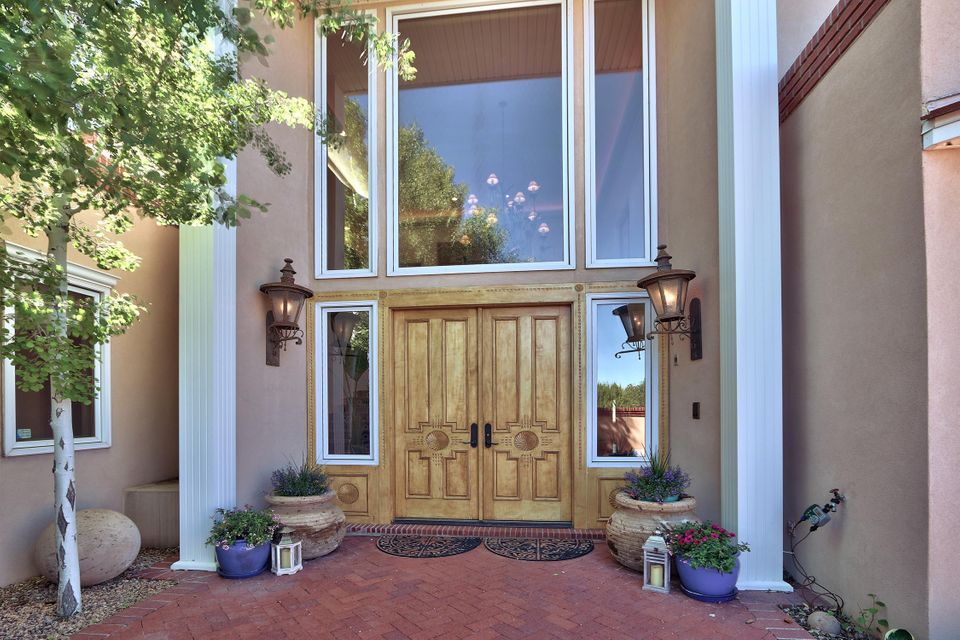 Looking for a great home at an exceptional price? This gracious territorial home w/every amenity is a remarkable value. GRAND ENTRANCE WITH BEAUTIFUL STAIRS AND EXQUISITE CHANDELIER are your first impression of the quality to follow. Spacious rooms,including extra bedrooms with ensuite baths are evidence no expense was spared.Dream kitchen with commercial stainless appliances opens to huge family space plus dining for 10 or even 20.Virtually every room has an unobstructed view of mountains or city lights. You will never want to leave this home which lives like a resort-gorgeous enclosed spa space with pool, hot tub and fireplace sitting area. Exceptional master w/sitting area, balcony and expansive views of city lights for a relaxed and private conversation.Amazing exercise room with view