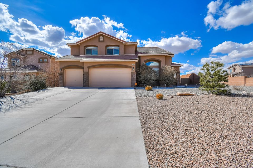 Come home to this spacious 5 bedroom home located on a large corner lot in the beautiful Diamond Ridge subdivision of Rio Rancho!! Home boasts soaring ceilings with amazing archways, 3 large living spaces, 2 dining areas, an enormous kitchen, and beautifully landscaped yards with large backyard covered patio! The gorgeous kitchen features granite countertops, stainless steel appliances, and large island/breakfast bar. You will find 1 bedroom with adjacent full bathroom downstairs and 4 spacious bedrooms plus a large loft upstairs. The loft opens up to a private balcony to enjoy New Mexico's beautiful weather. Don't miss out on all this space for a great price! Bring your family home to this amazing community with a highly rated school district today!