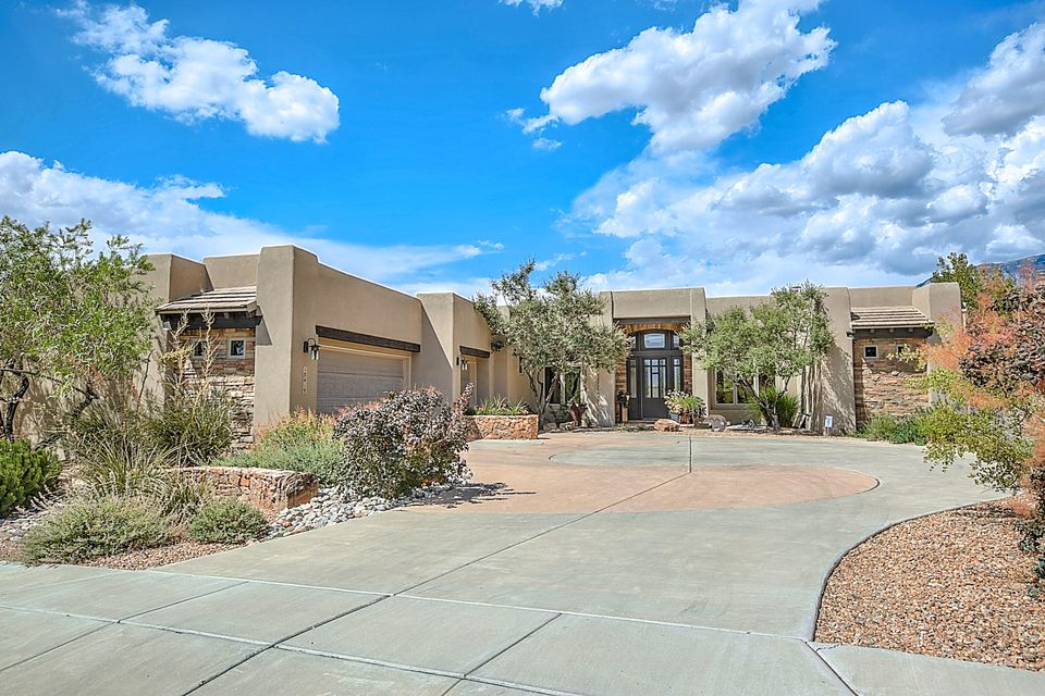 Exquisite High desert 1 story w/stunning mountain & city light views! Luxury abounds w/travertine & new hardwood in living room & master suite. Exceptional chef's kitchen w/6 burner Wolf range; custom cabinets; sparkling granite countertops & all stainless appliances; w/2 dishwashers & w/dramatic island bar. Great room features stone FP, new hardwood flooring & a wall of windows for outstanding views. Don't miss art studio space. Retreat to master w/new hardwood flooring & sit by fire or lounge in master tub or snail shower. Large study w/built-ins incl desk, closet & book shelves or 4th bedroom conveniently located near front door & kitchen. Dine on back patio; grill on built-in gas grill; enjoy the beautiful sunsets! New security door on front and epoxy finish on 3 car garage floor. More