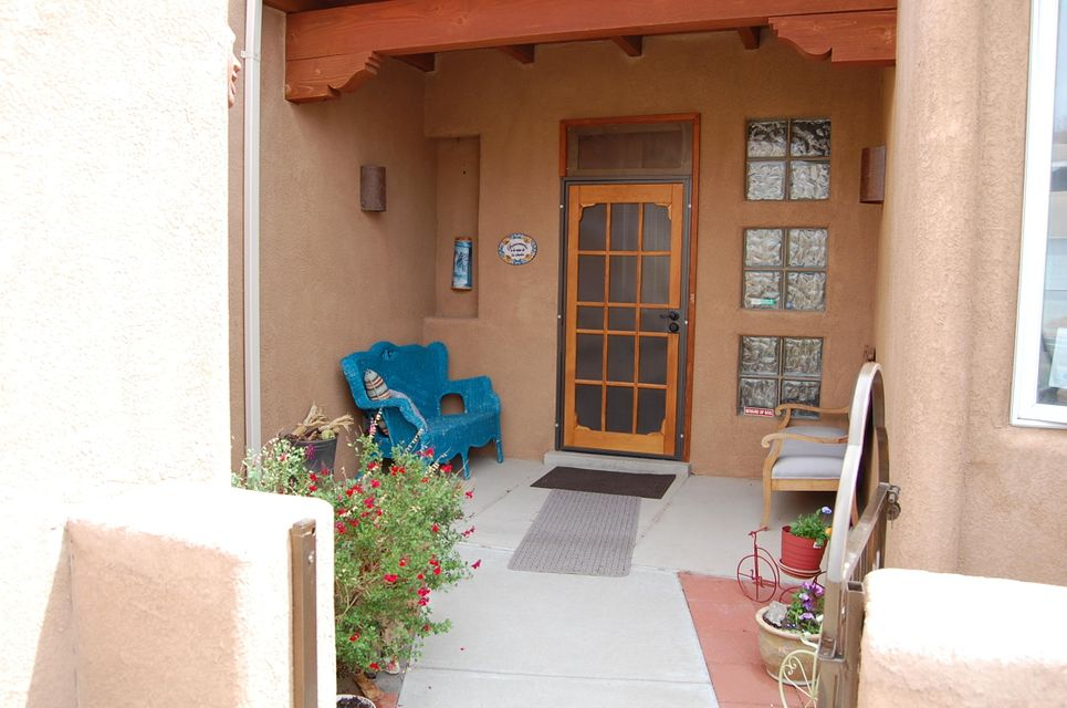 New owners will be welcomed by a charming private entry with a variety of flower beds, trees and room for morning sunrise coffee. Features:  Kiva Fireplace, Kitchen Island, Gas Cooktop, tile and apple wood flooring, vigas, nichos, canned lighting, man cave in garage, new air conditioner evap cooler and so much more.  Enjoy your evenings in your own back yard Oasis.  This home has been well-cared for and loved.  Close to shopping, parks, medical and Paseo Del Norte.  Bring your pre-qualified buyers today. Seller prefers Ashley Defillippo with Fidelity Title.